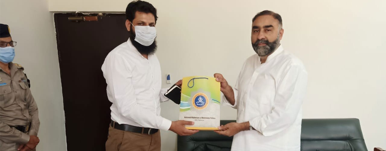 Dr. Ahsan Nazir (Director, ORIC) received a souvenir from DIG NHMP Headquarters